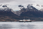 Tourists in zodiac inflatable boats travel back to the National Geographic Explorer expedition ship in Ainsworth Bay, Tierra del Fuego, Chile.