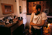 Bob Goodman, a rancher in Halfway, Oregon, lost his arm in a freak accident. Researchers at the University of Utah gave him a myoelectric arm, which he controls by flexing the muscles in his arm that are still intact. Sensors on the inside of the prosthetic arm socket pick up the faint electrical signals from the muscles and amplify them to control the robot arm. In this way, Goodman can do most things as he did before his accident. Here he is putting his arm on right after he wakes up and gets dressed in his bedroom.