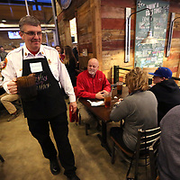 Tupelo Fire Chief Thomas Walker, brings out a pitcher of sweet tea to refill glasses at one of his tables during Celebrity Wait Night to benefit the Make a Wish Foundation Tuesday night at Mugshots Grill & Bar in Tupelo.