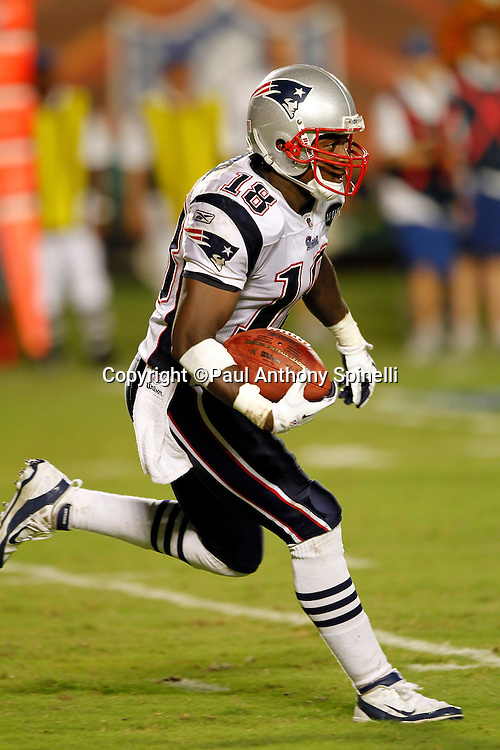 New England Patriots kick returner Matthew Slater (18) returns a third quarter kick during the NFL week 1 football game against the Miami Dolphins on Monday, September 12, 2011 in Miami Gardens, Florida. The Patriots won the game 38-24. ©Paul Anthony Spinelli