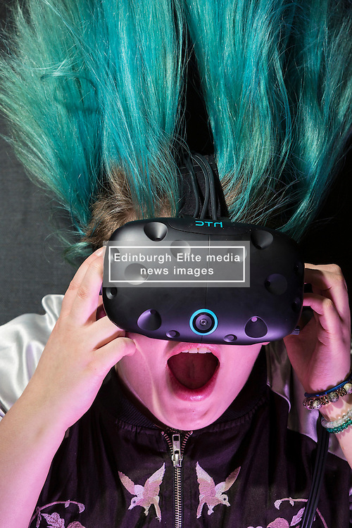 Scotland's first virtual reality arcade. E-VR opens on December 1 at Ocean Terminal, Edinburgh. It offers a variety of virtual reality  (VR) experiences and games. <br /> <br /> Pictured:  Holly Morton VR user with blue hair showcasing an HTC Vive headset.