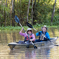 Lindblad Expeditions guests kayak in Nauta Creek off of the Maranon River in the Peruvian Amazon.