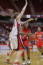 26 February 2009: Sonya Harris crouches to get an eye on the basket as Nicolle Lewis blocks her path. The Braves of Bradley  and the Illinois State Redbirds battled it out on Doug Collins Court inside Redbird Arena on the campus of Illinois State University, Normal Il.