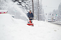 Dale Ruperd clears out the snow in front of his mailbox along 15th Street in Coeur d'Alene so the postman can deliver the mail Friday.