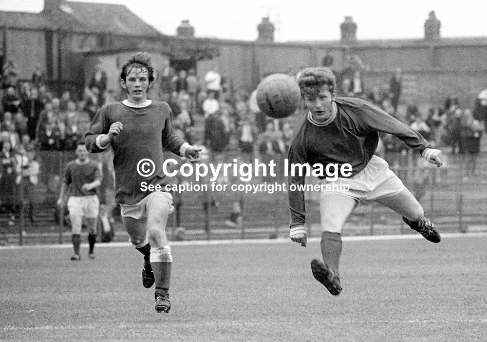 Isaac Andrews, footballer, Linfield FC, Belfast, N Ireland, right, heading the ball. Who is the other player on the left? Email me if you can help. 196908000222IA<br />
