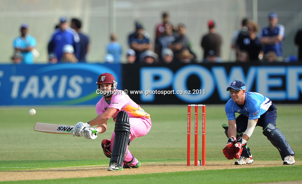 Anton Devcich batting as Gareth Hopkins looks on during the HRV Twenty20 Cricket match between the Auckland Aces and Northern Knights at Colin Maiden Oval in Auckland on Monday 26 December 2011. Photo: Andrew Cornaga/Photosport.co.nz
