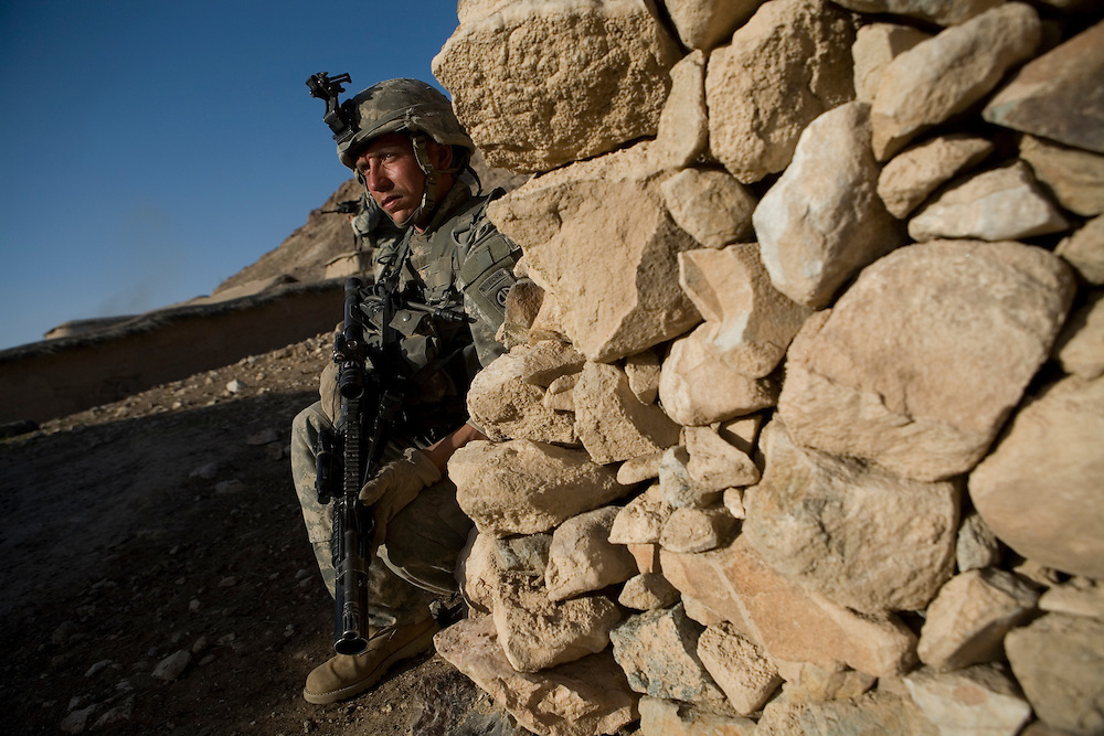 Specialist William White keeps watch while other soldiers of the 82nd Airborne hunt for Taliban in the remote mountain village of Bar Hajji Top in Kandahar province, Afghanistan on Saturday, March 24, 2007.