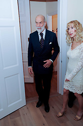 HRH PRINCE MICHAEL OF KENT and BASIA BRIGGS at a reception to celebrate the repairs on the Queen Elizabeth Gate in Hyde Park after it's successful repair following damaged sustained in a traffic accident in early 2010.  The party was held at 35 Sloane Gardens, London on 7th June 2010.