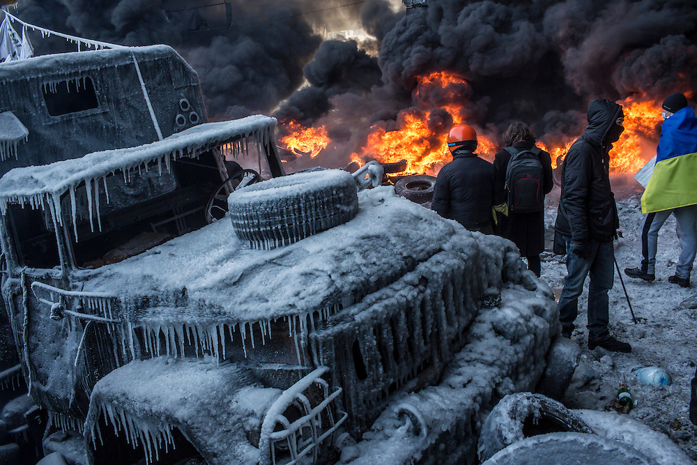 KIEV, UKRAINE - JANUARY 25: Anti-government protesters burn tires during clashes with police on Hrushevskoho Street near Dynamo stadium on January 25, 2014 in Kiev, Ukraine. After two months of primarily peaceful anti-government protests in the city center, new laws meant to end the protest movement have sparked violent clashes in recent days. (Photo by Brendan Hoffman/Getty Images) *** Local Caption ***