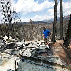 Todd Crist stands near the remains of his cabin in the Fall Creek area of Elmore County, Idaho, which was destroyed by the Elk Complex fire on August 10th. Thirty eight residences and 43 outbuildings in the Fall Creek area were destroyed by the Elk Complex of fires earlier this month. Wednesday August 28, 2013
