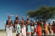 Africa. Northern Kenya. Nr Samburu National Park..Samburur warriors in full traditional costume..Tourist show..CD0011
