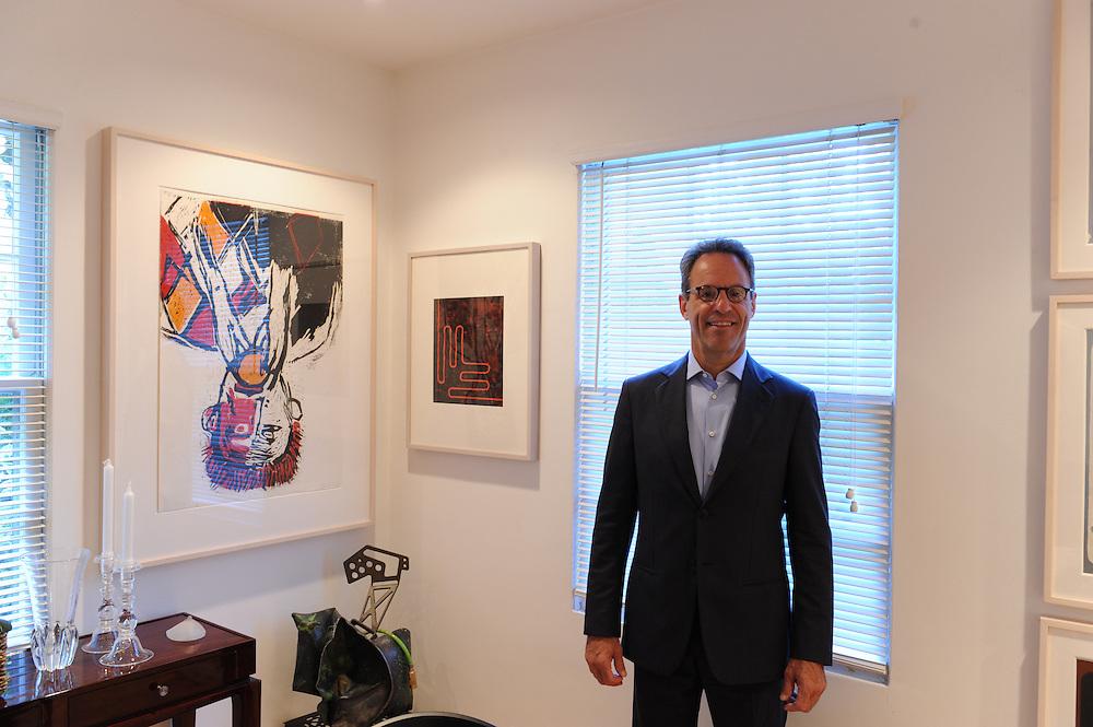 Art collector Marc Schwartz at his art packed house near Detroit, Michigan.<br /> <br /> Art in Detroit 2013<br /> &copy; Stefan Falke<br /> www.stefanfalke.com