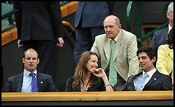 Geoffrey Boycott talks to Alastair Cook(right) and Andrew Strauss (left) in the Royal Box during Mariana Duque Marino from Colombia and <br /> Laura Robson of Great Britain game on Centre Court on day 5 of The All England Lawn Tennis Club, Wimbledon, United Kingdom, Robson went on to win the game.<br /> Friday, 28th June 2013<br /> Picture by Andrew Parsons / i-Images