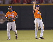 Florida's Jeff Corsaletti (R) pumps his fist in the air, as he and Gavin Dickey (L) leave the field after the Gators beat the Huskers.  Florida defeated Nebraska in the second round of the College World Series 7-4 at Rosenblatt Stadium in Omaha, Nebraska on June 19, 2005.