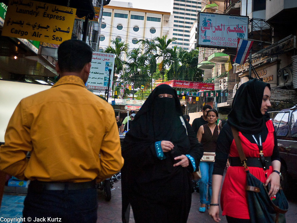 06 JULY 2011 - BANGKOK, THAILAND: Arab women walk through the Soi Arab neighborhood in Bangkok. Soi Arab is an alleyway in Bangkok. What started as an alley has now grown into a neighborhood that encompasses several blocks of restaurants, hotels and money exchanges that cater to Middle Eastern visitors to Thailand. The official name of the street is Sukhumvit Soi 3/1, located in North Nana between Sukhumvit Soi 3 and Sukhumvit Soi 5, not far from the Nana Plaza night-life area and the Grace Hotel popular among Arabs.   PHOTO BY JACK KURTZ