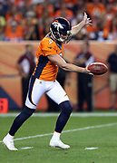 Denver Broncos punter Riley Dixon (9) punts for 42 yards in the fourth quarter during the 2016 NFL week 1 regular season football game against the Carolina Panthers on Thursday, Sept. 8, 2016 in Denver. The Broncos won the game 21-20. (©Paul Anthony Spinelli)