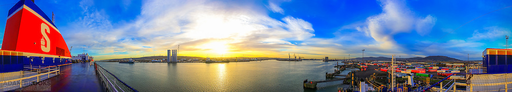 Full 360 degree panorama of Belfast Harbour from the Belfast-Birkenhead Ferry on a December morning, with the low winter sun providing a lovely golden glow to the view.