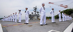 YOKOSUKA, Japan (May 16, 2017) Sailors stand at parade rest on the flight deck of the aircraft carrier USS Ronald Reagan (CVN 76) as the ship prepares to commence its 2017 patrol. Ronald Reagan is the flagship of Carrier Strike Group 5, providing a combat-ready force that protects and defends the collective maritime interests of its allies and partners in the Indo-Asia-Pacific region. (U.S. Navy photo by Mass Communications Specialist 2nd Class Kenneth Abbate/Released)170516-N-OY799-194 <br /> Join the conversation:<br /> http://www.navy.mil/viewGallery.asp<br /> http://www.facebook.com/USNavy<br /> http://www.twitter.com/USNavy<br /> http://navylive.dodlive.mil<br /> http://pinterest.com<br /> https://plus.google.com