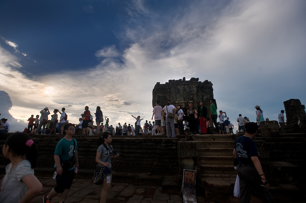 Tourists gather at the top of Phnom Bakheng, a temple in the park and a favorite during sunrises and sunsets.