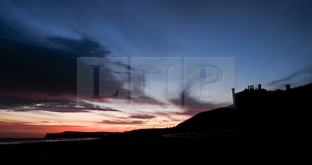 © Licensed to London News Pictures. 25/01/16<br /> Marske-by-the-Sea, UK. <br /> <br /> Early morning clouds over Marske by the Sea near Redcar are dramatically lit by the sunrise. Remnants of Storm Jonah are expected to bring weather disruption to parts of the country over the next few days.<br /> <br /> Photo credit : Ian Forsyth/LNP