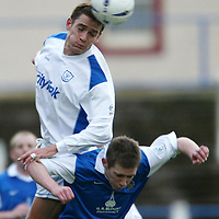 Queen of the South v St Johnstone..1.11.03<br />Paul Bernard outrjumps Brian McColligan<br /><br />Picture by Graeme Hart.<br />Copyright Perthshire Picture Agency<br />Tel: 01738 623350  Mobile: 07990 594431
