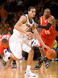 Virginia guard Mustapha Farrakhan (2) dribbles the ball up court against VMI.The Virginia Cavaliers defeated the Virginia Military Institute Keydets 107-97 in NCAA Basketball at the John Paul Jones Arena on the Grounds of the University of Virginia in Charlottesville, VA on November 16, 2008.