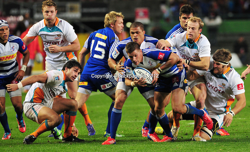 Louis Schreuder of the Stormers is held back by Sarel Pretorius of the Cheetahs of the Cheetahs during the 2013 Super Rugby game between the Stormers and the Cheetahs at Newlands Rugby Stadium on 29 June 2013 ©Ryan Wilkisky/BackpagePix