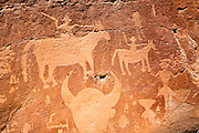 Petroglyphs of Spanish conquistadors with swords on horseback. The carvings were the creation of the Dinetah, the ancestors of the Navajo people. Largo Canyon, New Mexico.