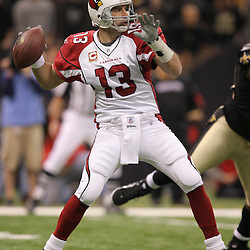 16 January 2010:  Arizona Cardinals quarterback Kurt Warner (13) throws a pass against the Arizona Cardinals during the first half of the 2010 NFC Divisional Playoff game at the Louisiana Superdome in New Orleans, Louisiana.