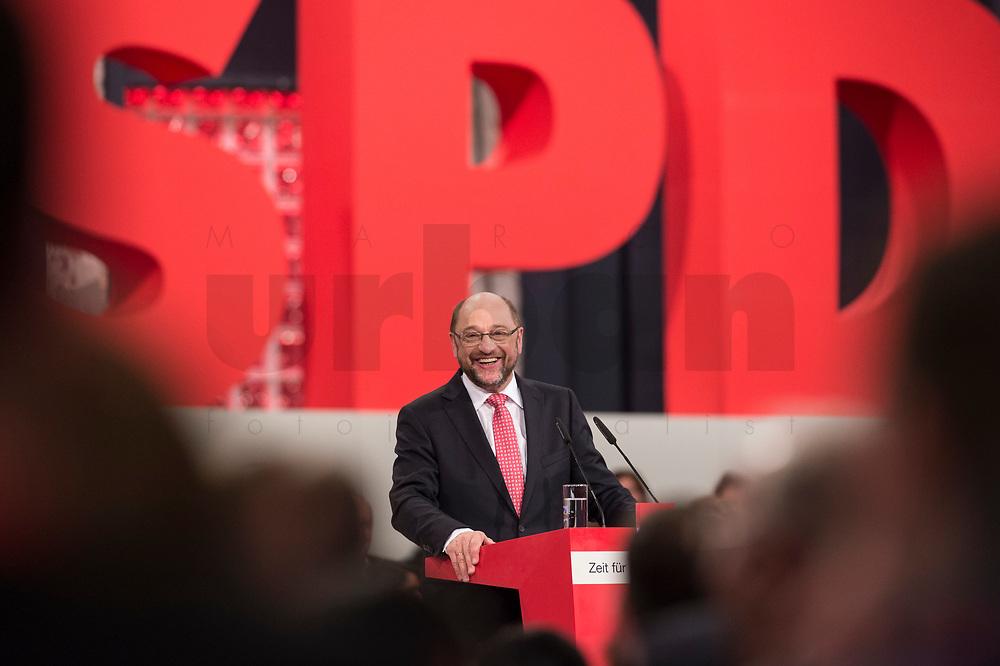 19 MAR 2017, BERLIN/GERMANY:<br /> Martin Schulz, SPD, haelt seine Rede vor seiner Wahl zum SPD Parteivorsitzenden und SPD Spitzenkandidat der Bundestagswahl, a.o. Bundesparteitag, Arena Berlin<br /> IMAGE: 20170319-01-030<br /> KEYWORDS: party congress, social democratic party, candidate, freundlich, lacht, lachen, speech