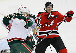 Mar 20, 2009; Newark, NJ, USA; New Jersey Devils center Travis Zajac (19) and Minnesota Wild defenseman Martin Skoula (41) battle for the loose puck during the third period at the Prudential Center.  The Devils defeated the Wild 4-0.