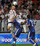 30-08-2008 VOETBAL:WILLEM II:AJAX:TILBURG<br /> Danny Schenkel en Ibrahim Kargbo vliegen achter de bal aan bij Klaas Jan Huntelaar<br /> Foto: Geert van Erven