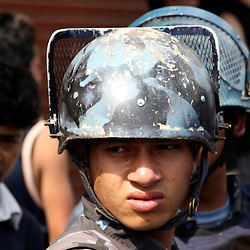Nepali riot police confront Marxist rioters during civil disturbances, Kathmandu, Nepal, 2009