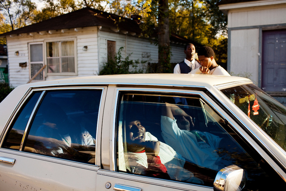 "Jabari Wilson (center) gets drunk in a car with friends following the funeral of their friend Demetrius ""Butta"" Anderson, 18, in the Baptist Town neighborhood of Greenwood, Mississippi on Friday, November 5, 2010. Butta was murdered the week before."