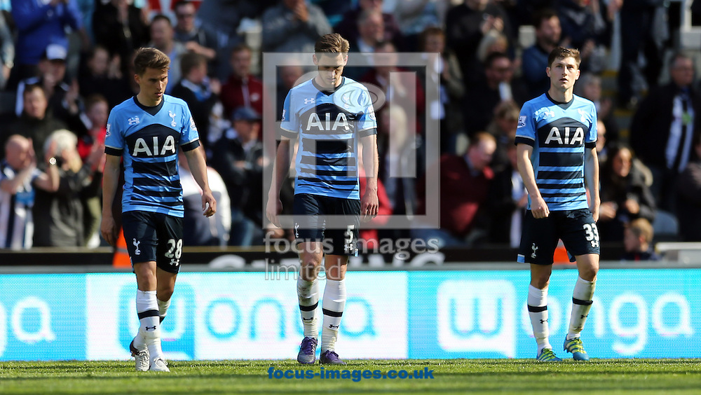 Tom Carroll (l), Jan Vertonghen (c) and Ben Davies (r) of Tottenham Hotspur dejected after conceding a fifth during the Barclays Premier League match at St. James's Park, Newcastle<br /> Picture by Simon Moore/Focus Images Ltd 07807 671782<br /> 15/05/2016