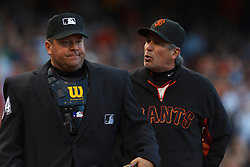 July 23, 2011; San Francisco, CA, USA;  San Francisco Giants bench coach Ron Wotus (right) argues with MLB umpire Sam Holbrook (left) after being ejected for arguing a call during the fourth inning against the Milwaukee Brewers at AT&T Park. San Francisco defeated Milwaukee 4-2.