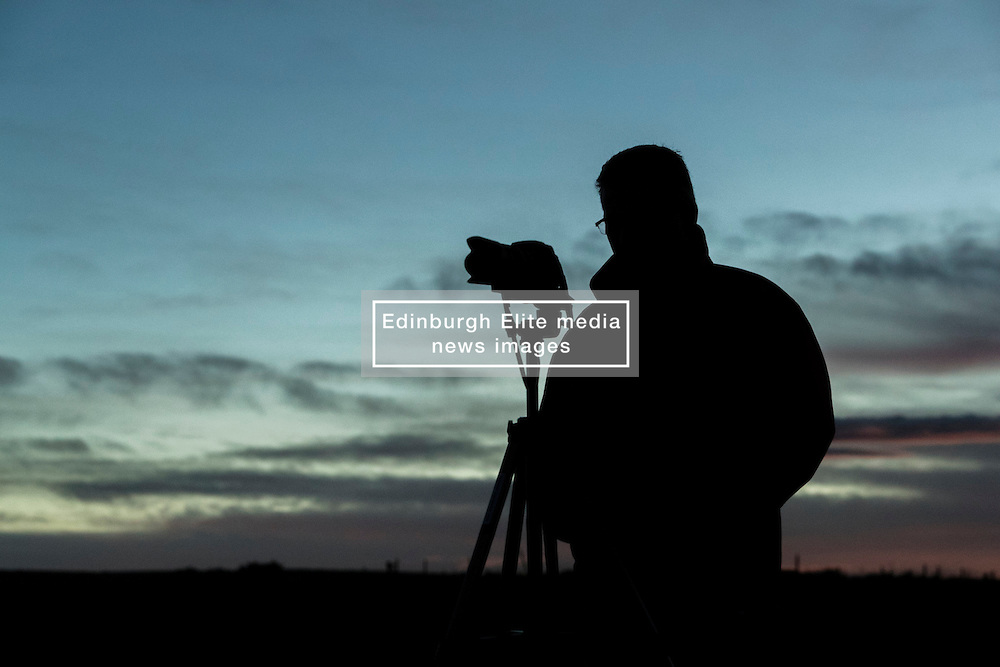 Despite predictions of the North East of Scotland being the likeliest place to see the Super Moon, scores of photographers were disappointed with a brief view as the moon hit the horizon but then briefly dipped behind the clouds at Dunnottar Caste, near Stonehaven.