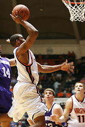 Virginia guard J.R. Reynolds (2) leaps to the hoop against Northwestern.  Reynolds had 13 points on the night as UVA beat the Wildcats 72-57...The Virginia Cavaliers Men's Basketball team defeated the Northwestern Wildcats 72-57 in the ACC/BigTen Challenge at University Hall in Charlottesville, VA on November 30, 2005..