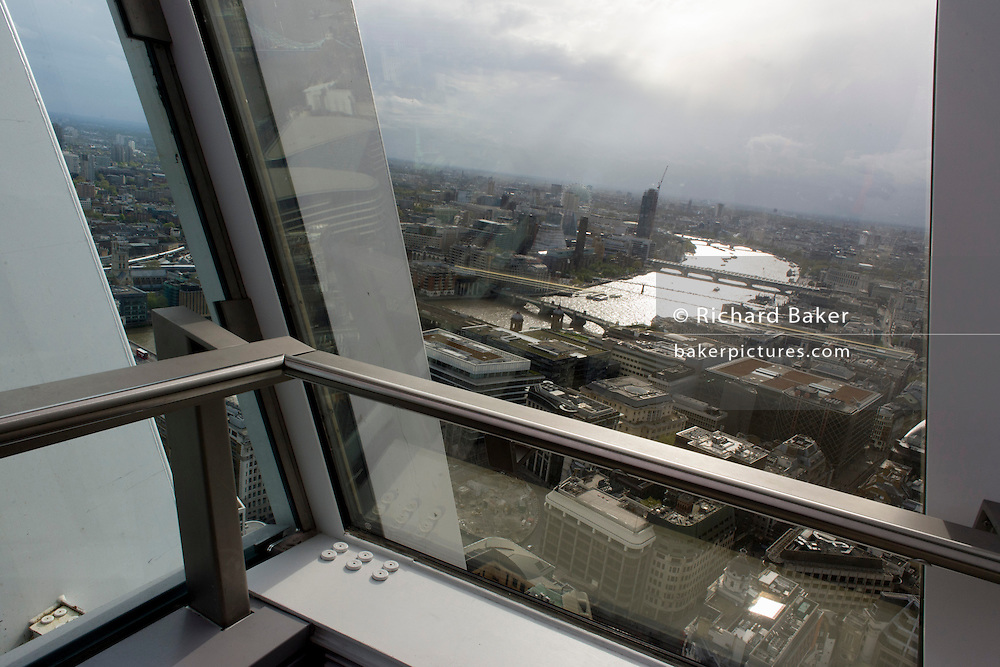London's skyline and River Thames seen from the Sky Garden of the Walkie Talkie building in the City of London.