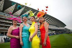 © London News Pictures. 18/06/2013. Ascot, UK.  A group of women in elaborate hats on day one of Royal Ascot at Ascot racecourse in Berkshire, on June 18, 2013.  The 5 day showcase event,  which is one of the highlights of the racing calendar, has been held at the famous Berkshire course since 1711 and tradition is a hallmark of the meeting. Top hats and tails remain compulsory in parts of the course. Photo credit should read: Ben Cawthra/LNP