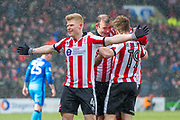 Lincoln City Midfielder Elliott Whitehouse celebrates Lincoln City Forward Matt Green scoreing 2-0 during the EFL Sky Bet League 2 match between Lincoln City and Grimsby Town FC at Sincil Bank, Lincoln, United Kingdom on 17 March 2018. Picture by Craig Zadoroznyj.