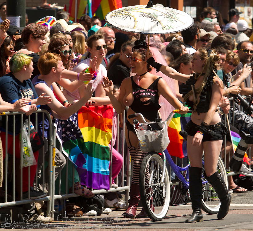 Two semi-nude women entertain spectators on Market Street at the 43rd annual San Francisco Pride parade, Sunday, June 30, 2013 in San Francisco. (Photo by D. Ross Cameron)