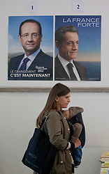 © licensed to London News Pictures. London, UK 06/05/2012. A French woman waiting next to the Presidential contenders' posters inside the French Embassy in London to vote the second round of Presidential Elections, this noon (06/05/12). Photo credit: Tolga Akmen/LNP