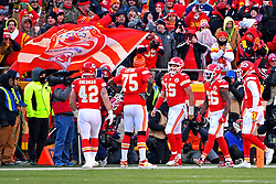 Jan 19, 2020; Kansas City, Missouri, USA; Kansas City Chiefs quarterback Patrick Mahomes (15) celebrates after scoring a touchdown during the first half against the Tennessee Titans in the AFC Championship Game at Arrowhead Stadium. Mandatory Credit: Denny Medley-USA TODAY Sports