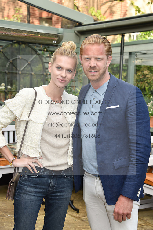 Alistair Guy and Barbora Bediova at The Ivy Chelsea Garden's Annual Summer Garden Party, The Ivy Chelsea Garden, 197 King's Road, London England. 9 May 2017.<br /> Photo by Dominic O'Neill/SilverHub 0203 174 1069 sales@silverhubmedia.com