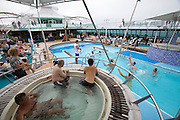 Aboard the Rhapsody of the Seas, on a cruise from Vancouver to Hawaii. Pool Deck. Pool Volleyball competition guests vs. crew.
