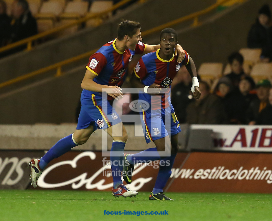 Picture by Daniel Weir/Focus Images Ltd +44 7982 911743.02/10/2012.Wilfred Zaha of Crystal Palace Celebrates his second goal of the match against Wolverhampton Wolves for Crystal Palace with his team mate Joel Ward during the npower Championship match at Molineux, Wolverhampton.