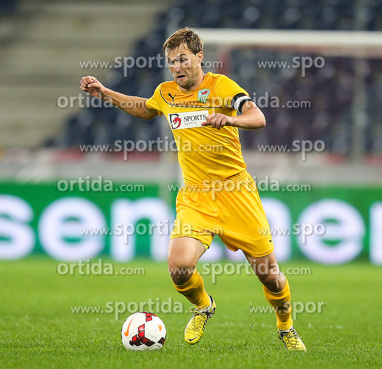 31.07.2014, Red Bull Arena, Salzburg AUT, UEFA EL Qualifikation, FC Groedig vs FC Zimbru Chisinau, dritte Runde, Hinspiel, im Bild Gheroghe Anton, (FC Zimbru Chisinau, #7) // during UEFA Europe League Qualifier first leg 3rd round between FC Groedig and FC Zimbru Chisinau at the Red Bull Arena in Salzburg, Austria on 2014/07/31. EXPA Pictures © 2014, PhotoCredit: EXPA/ Roland Hackl