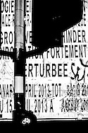 Summer 2015. Brussels. Semaphore and works poster at night.