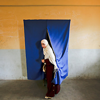An Egyptian woman leaves a voting booth at a polling station in Alexandria, Egypt. Egyptian police restricted voting in areas contested by the opposition Muslim Brotherhood on Saturday and detained hundreds of Islamists trying to build on early success in parliamentary elections. November 2005.